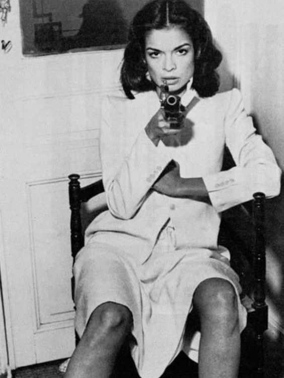 Bianca Jagger in Yves Saint Laurent suit