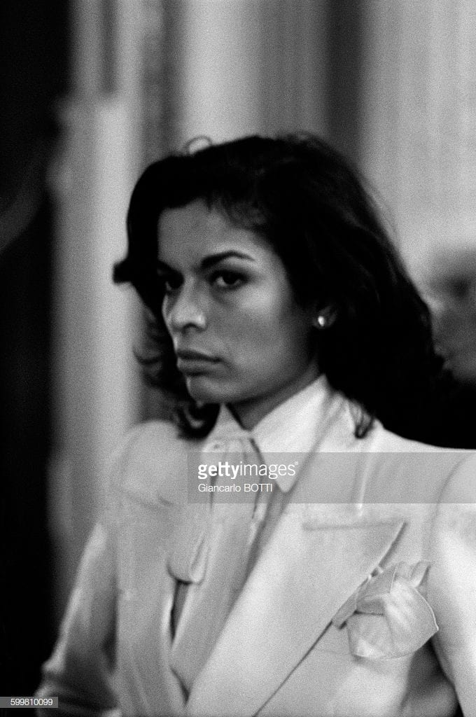 1977: Bianca Jagger walks the runaway during the Yves Saint Laurent Haute Couture Fashion Show